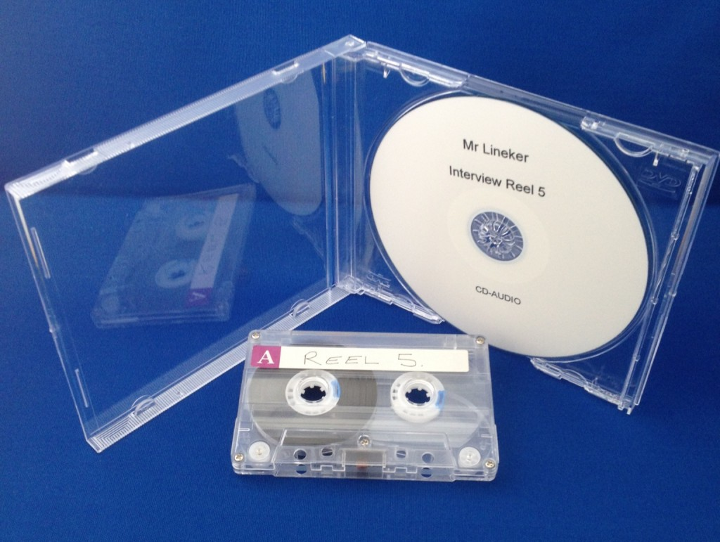 Shows an audio cassette tape and a CD Audio Disc